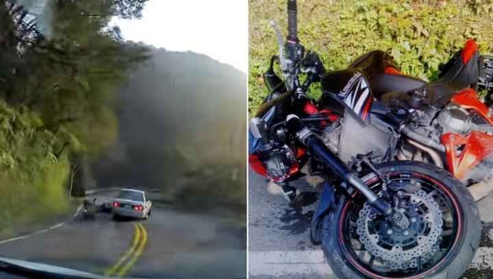 白色BMW跨越雙黃線,撞飛大型重機騎士。記者江孟謙/翻攝