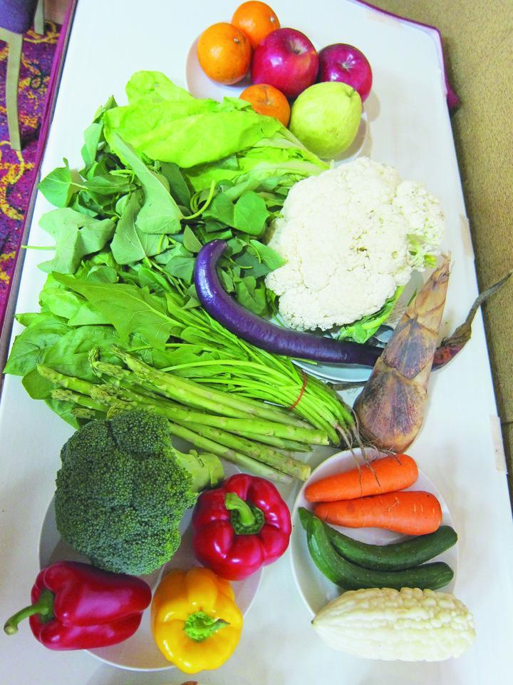 避免戴奧辛,建議多吃蔬果。圖/本報資料照片