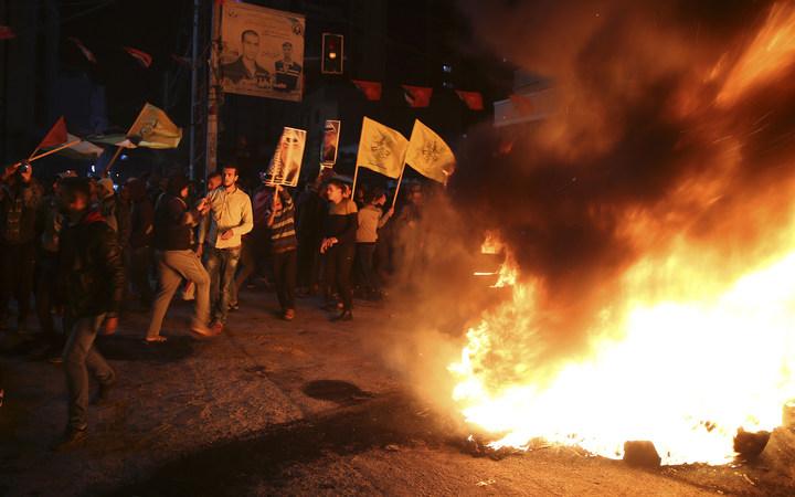 巴勒斯坦人6日在加薩市發動反美示威,抗議美國總統川普承認耶路撒冷為以色列首都。美聯社