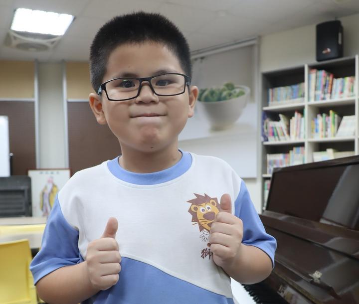 獅甲國小三年級全盲生羅柏勛未來想當總統,才有力量幫助更多需要幫助的人。記者徐如宜/攝影